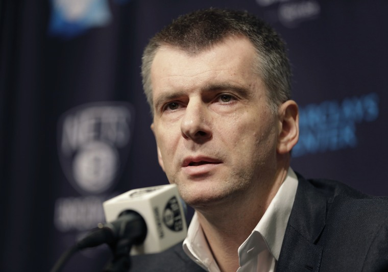 Image: Mikhail Prokhorov speaks during an NBA basketball news conference