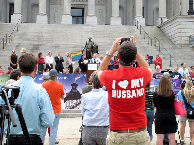 Image: Trevor Donovan takes pictures at a Statehouse rally