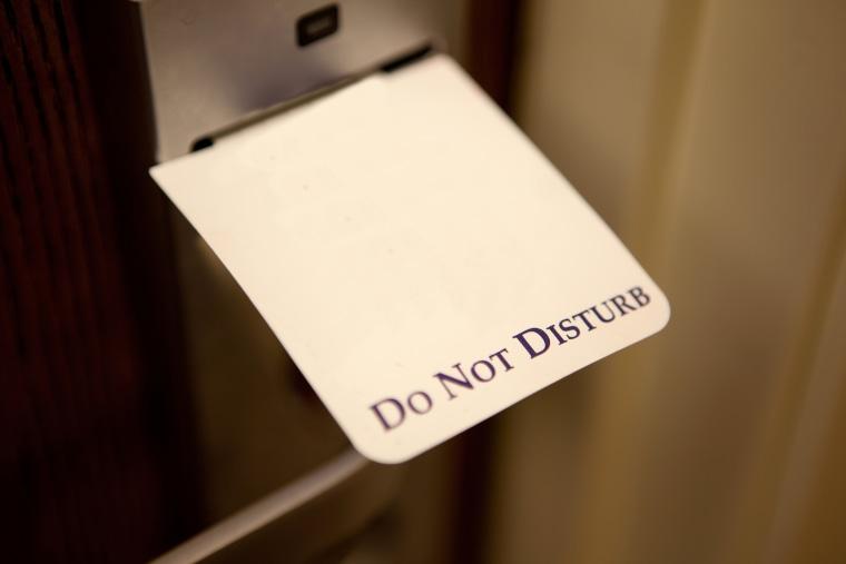 Image: Do not disturb sign in a hotel door