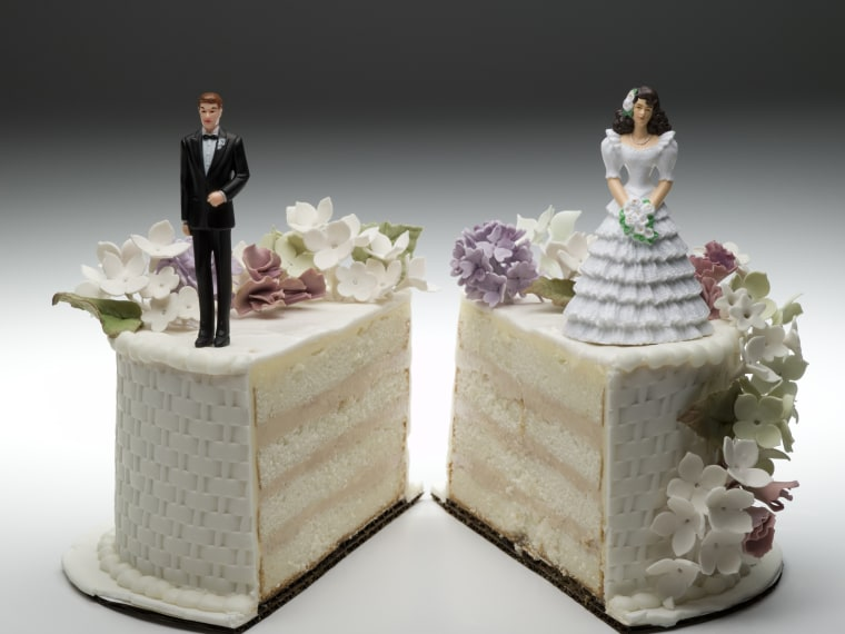 Photo: Bride and groom figurines standing on two separated slices of wedding cake