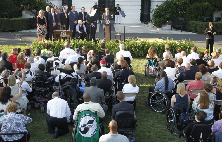 Image: Obama speaks at an event marking the 20th anniversary of the Americans with Disabilites Act