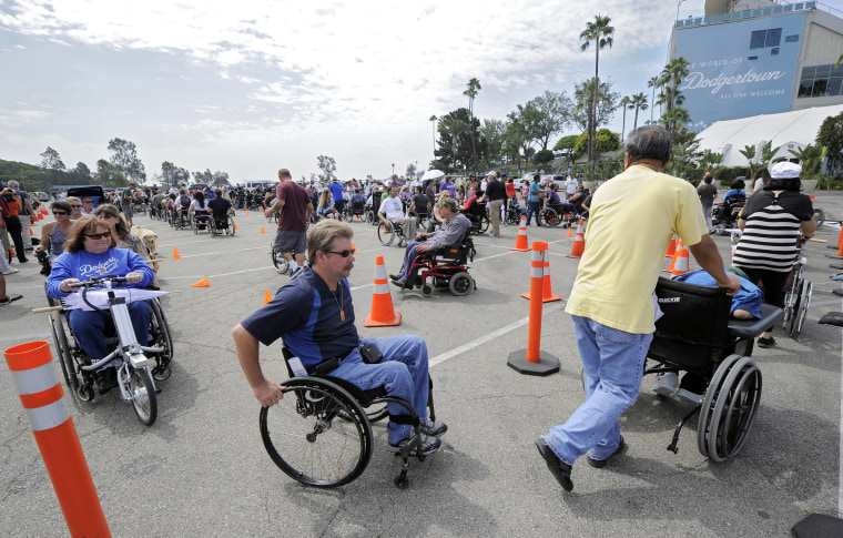 Image: People in wheelchairs set a record marking