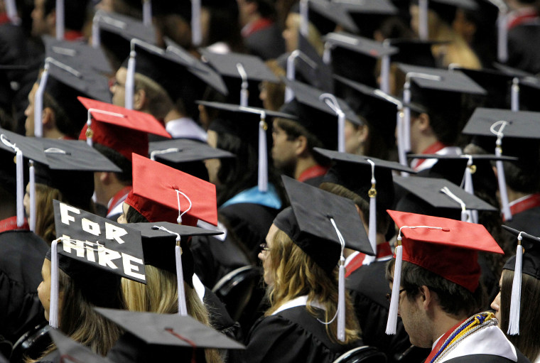 Image: Students attend graduation ceremonies at the University of Alabama in Tuscaloosa, Alabama on Aug. 6, 2011.