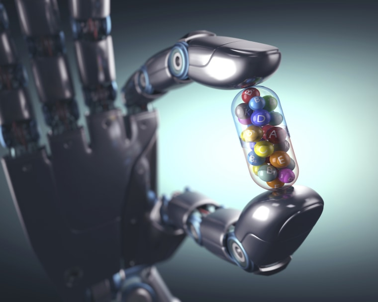 Image: Robotic hand holding multivitamin, illustration.