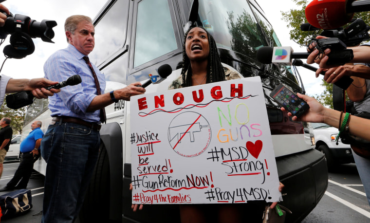 Image: Tyra Hemans, 19, a senior at Marjory Stoneman Douglas High School, speaks before boarding busses with other students to travel to Tallahassee, Florida, to meet with legislators, in Coral Springs