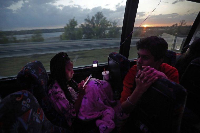 Image: Tyra Hemans, 19, left, and Tanzil Philip, 16, student survivors from Marjory Stoneman Douglas High School, speak on the bus
