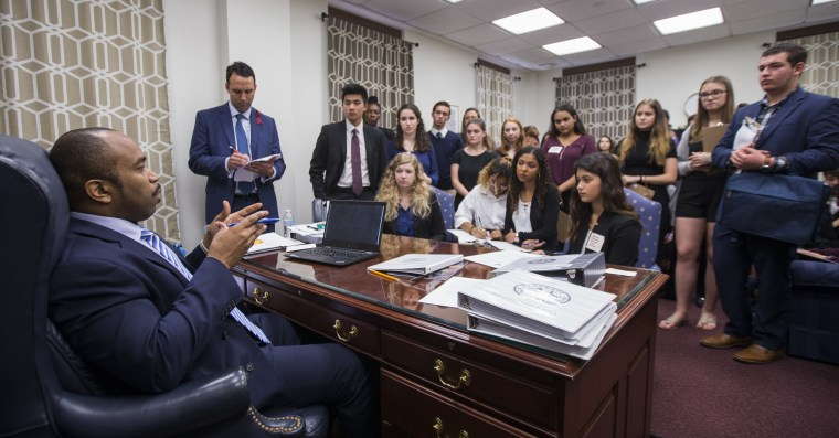 Image: Sen. Bobby Powell talks with survivors from Marjory Stoneman Douglas High School