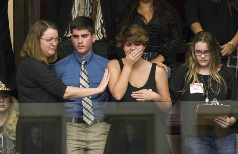 Image: Sheryl Acquarola a 16 year-old junior from Marjory Stoneman Douglas High School is overcome with emotion