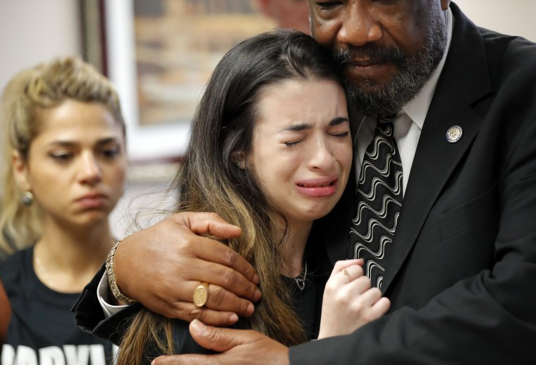 Image: Aria Siccone, 14, a 9th grade student from Marjory Stoneman Douglas High School, cries