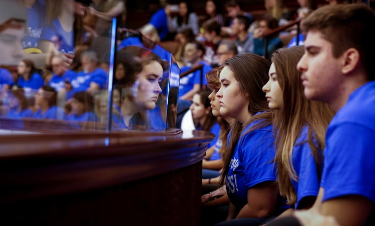Image: Students from Marjory Stoneman Douglas High School look on from the gallery above the Florida Senate after the Senate honoured the victims of last week's mass shooting on their campus, in Tallahassee