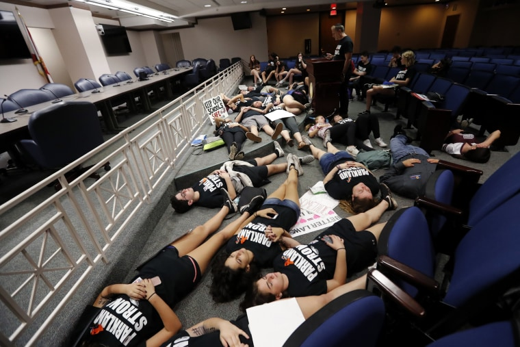 Image: Seventeen students from Marjory Stoneman Douglas High School  lie down on the floor in silence and pray