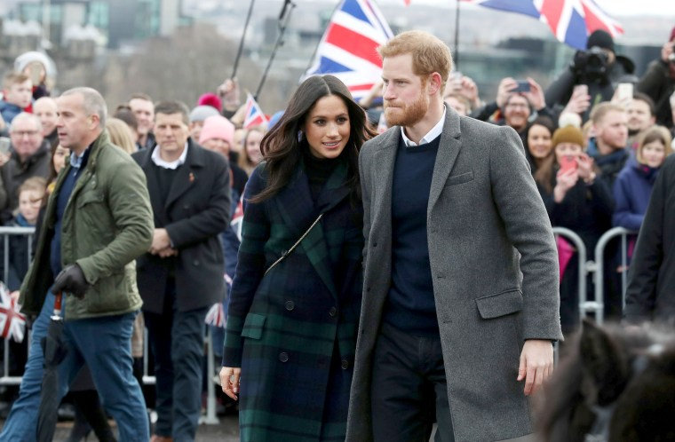 Image: Meghan Markle and Britain's Prince Harry, meet members of the public during a walkabout on the esplanade at Edinburgh Castle