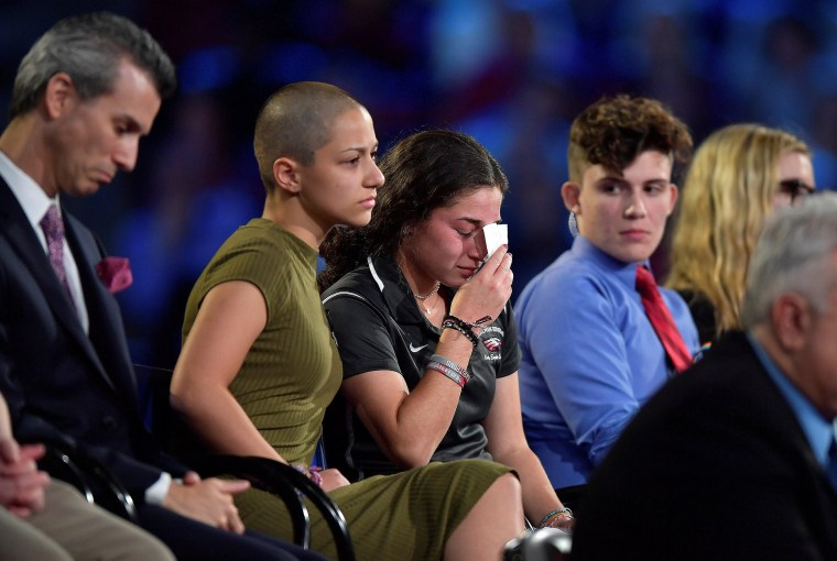 Image: Marjory Stoneman Douglas High School student Emma Gonzalez comforts a classmate during a CNN town hall meeting, at the BB&T Center, in Sunrise