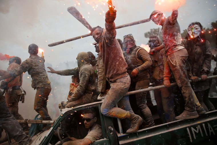 "Image: Revellers celebrate ""Ash Monday"" by participating in a colourful ""flour war"", a traditional festivity marking the end of the carnival season and the start of the 40-day Lent period until the Orthodox Easter, in Galaxidi"