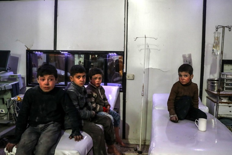 Injured children receive medical treatment after bombings on Mesraba on Feb. 19.
