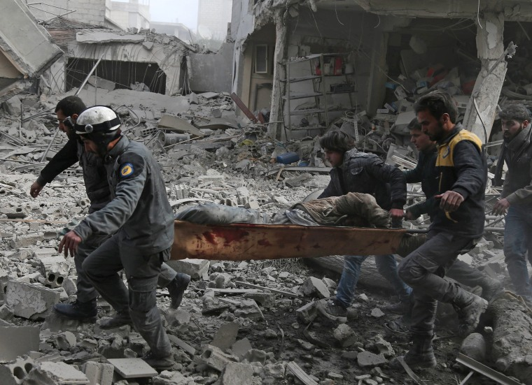 Members of the Syrian Civil Defense evacuate an injured civilian on Feb. 20.