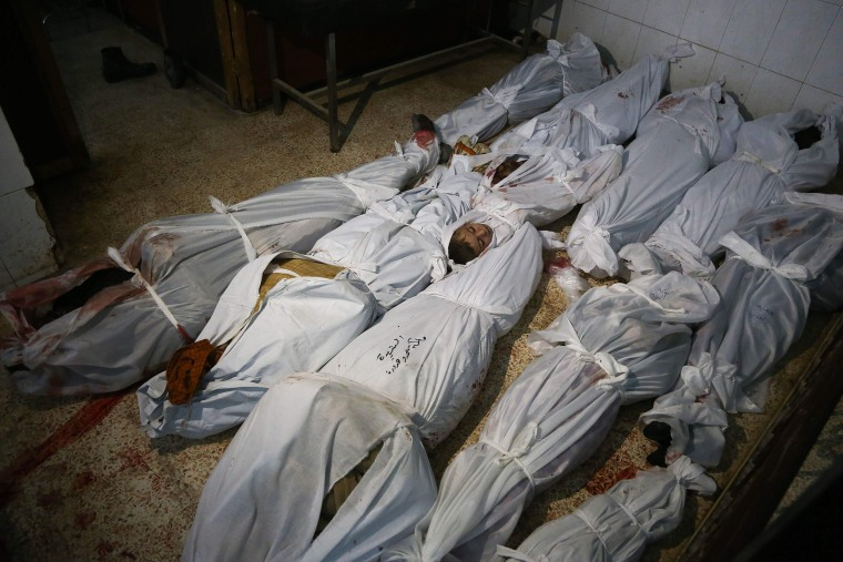 Civilian bodies lay on the ground at a make-shift morgue on Feb. 20.