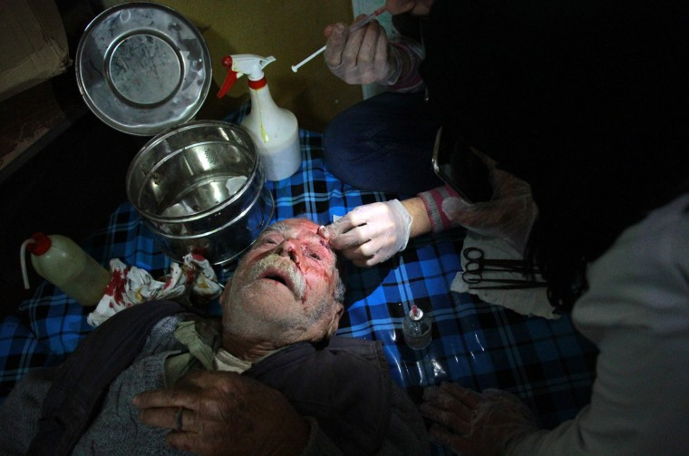 A wounded Syrian receives first aid treatment on Feb. 20.