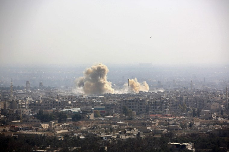 Smoke rises from the distant towns of Arbin and Harasta in this photograph from a government-controlled area on the outskirts of Harasta on the northeastern suburbs of Damascus on Feb. 21.