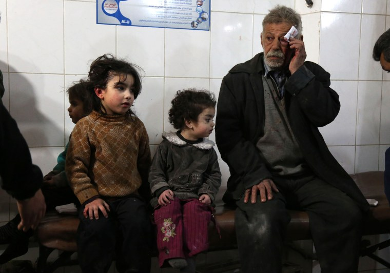 Wounded Syrians wait to receive treatment in Kafr Batna on Feb. 21.