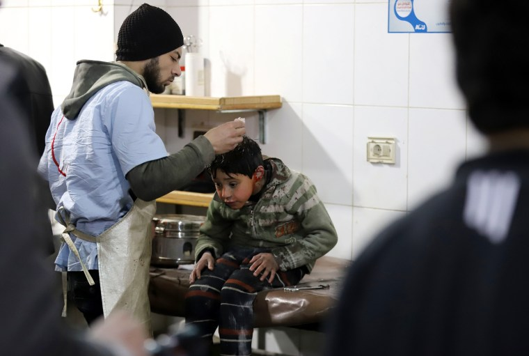 A wounded boy is treated at a make-shift hospital in Kafr Batna on Feb. 21.