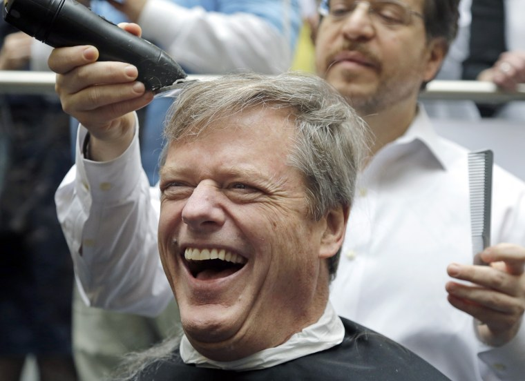 Image: Charlie Baker buzz cut during fundraiser