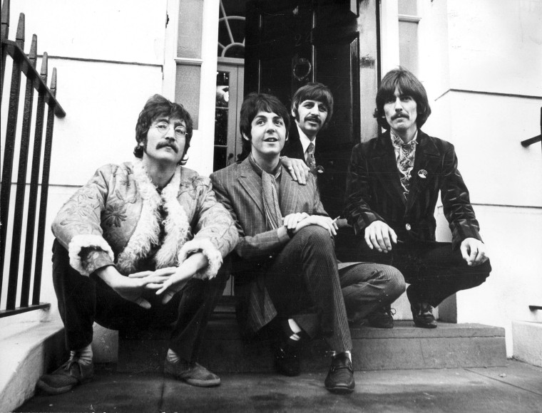 Image: The Beatles sitting outside studios in North London January 1967.
