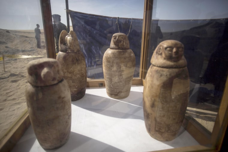 Image: Four canopic jars, made of alabaster with lids bearing the faces of the four sons of god Horus, that were unearthed are displayed at the site of an ancient Egyptian cemetery, in Minya province, 245 km south of Cairo, Egypt, on Feb. 24, 2018.