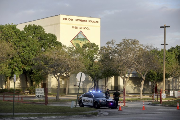 Image: Police watch the entrance of a parking lot at Marjory Stoneman Douglas High School on Feb. 23, 2018 in Parkland, Florida. Teachers and administrators returned for the first time since the Valentine's Day shooting that killed several people.