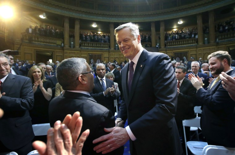 Image: Massachusetts Republican Gov. Charlie Baker greets law makers and guests as he enters the House chamber at the Statehouse before his State of the State address, on Jan. 24, 2017, in Boston.