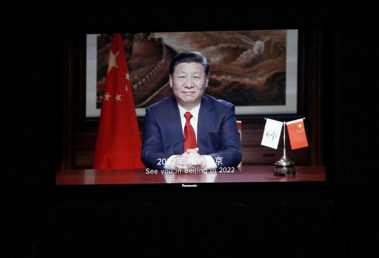 China's President Xi Jinping on screen in a video message sent for the closing ceremony.