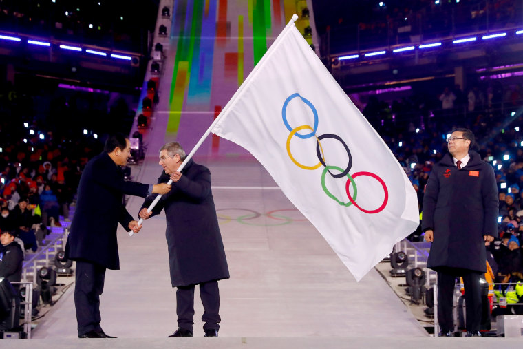 Mayor of PyeongChang Sim Jae-guk, President of the International Olympic Committee Thomas Bach and Mayor of Beijing Chen Jining participate in the Olympic flag handover ceremony.