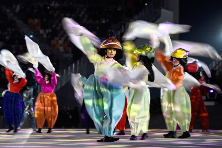 Performers dance during the closing ceremony.