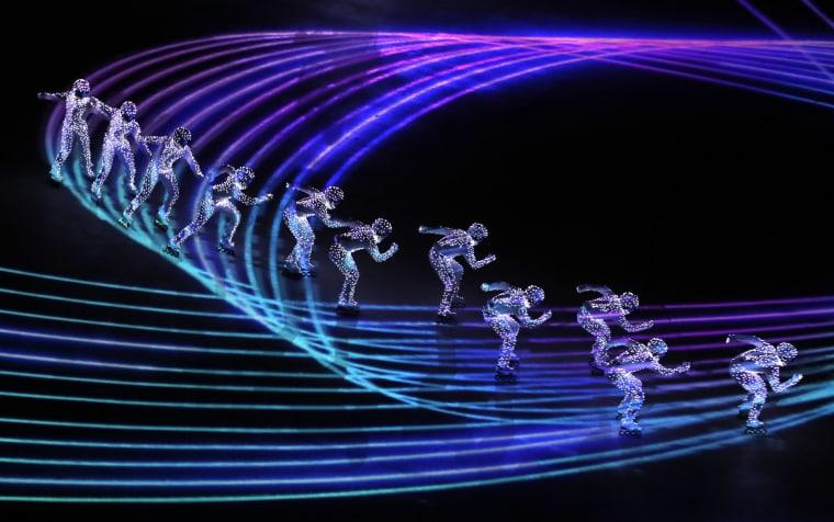 Artists perform a light show.