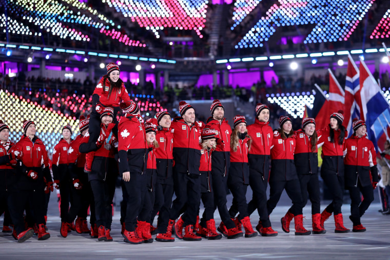 Team Canada walks in the Parade of Athletes.