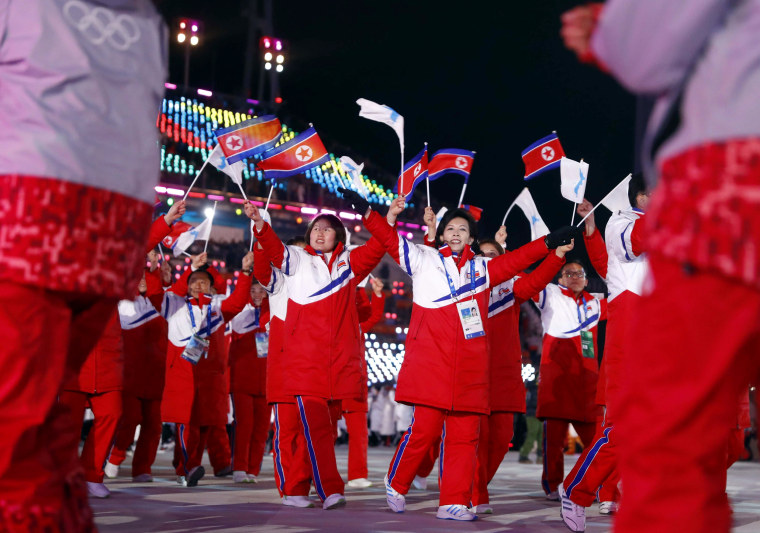 The delegation of the unified Korea team enters the stadium.