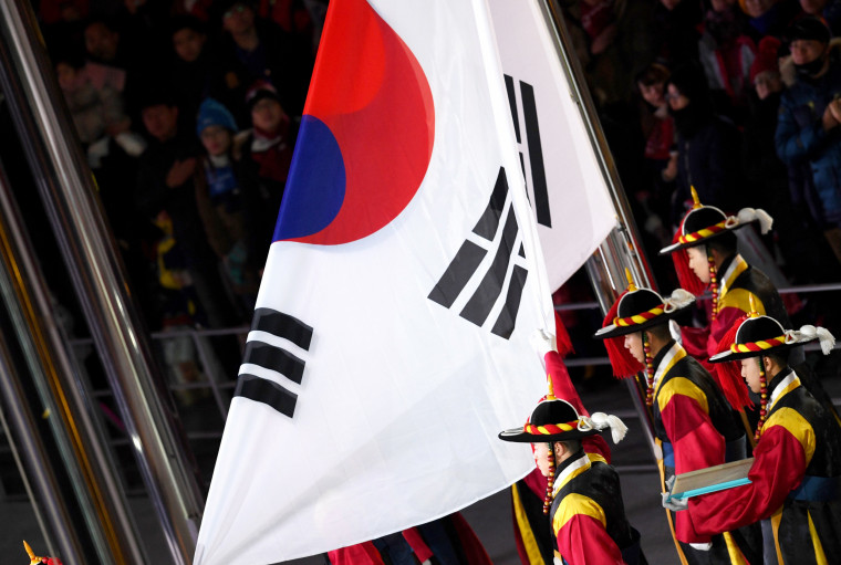 The South Korean Traditional Guard raises the Korean national flag.
