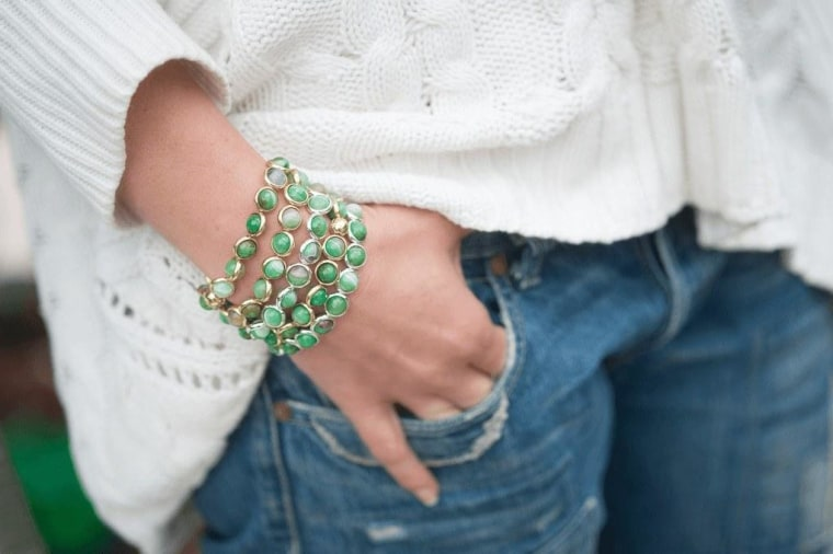 Green stack bracelets with jeans