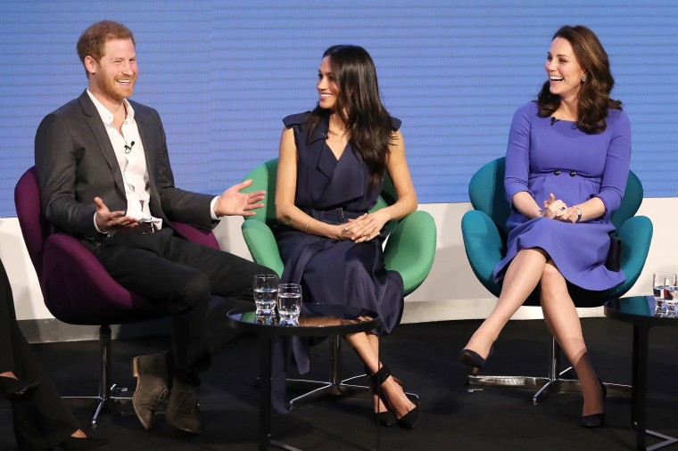 Prince Harry, Meghan Markle and Catherine, Duchess of Cambridge  attend the first annual Royal Foundation Forum held at Aviva on February 28, 2018 in London. Under the theme 'Making a Difference Together', the event will showcase the programs run or initiated by The Royal Foundation. Markle wore a a belted blue satin wrap dress by Jason Wu with Aquazzura's Casablanca Pumps in black.
