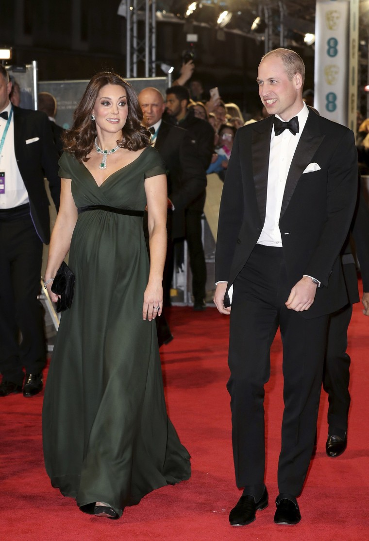 Britain's Prince William and Kate, Duchess of Cambridge arrive for the BAFTA 2018 Awards in London, Sunday, Feb. 18, 2018. The duchess wore an elegant forest green Jenny Packham dress, paired with a dazzling diamond and emerald necklace, bracelet and earring set.
