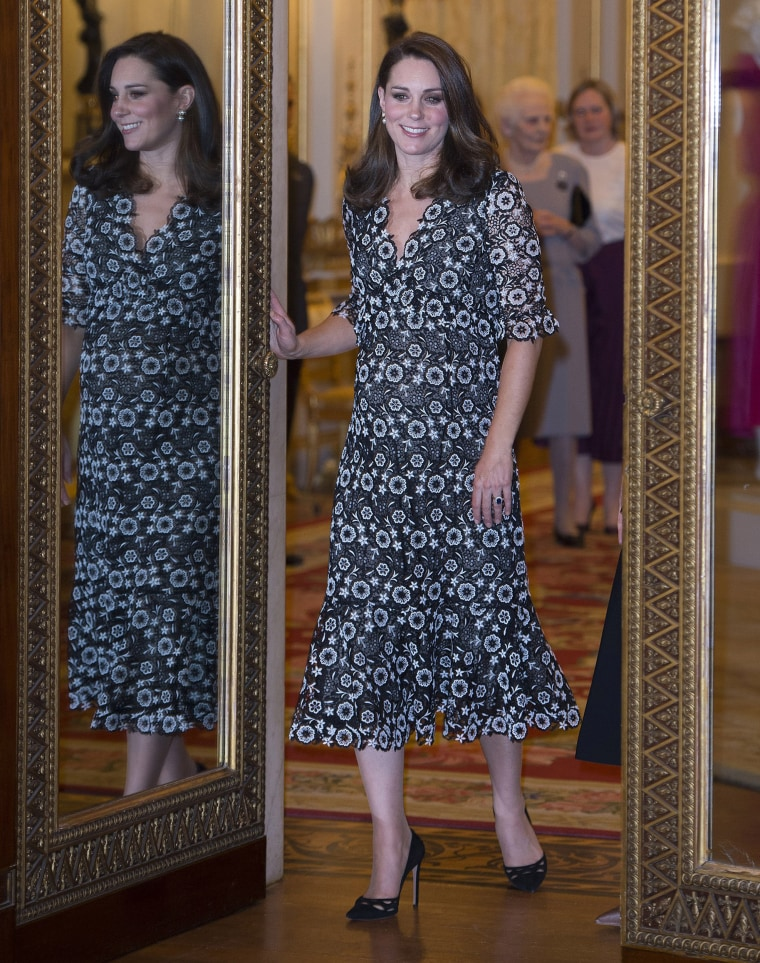 Catherine, Duchess of Cambridge attends The Commonwealth Fashion Exchange Reception at Buckingham Palace on February 19, 2018 in London. She wore a black and white floral-printed Erdem gown.
