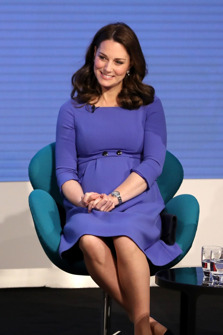 Catherine, Duchess of Cambridge attends the first annual Royal Foundation Forum held at Aviva on February 28, 2018 in London. She wore a royal blue maternity dress by S?raphine.