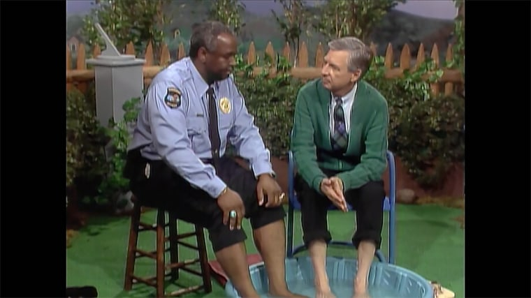 """In a 1968 episode of """"Mister Rogers' Neighborhood,"""" Rogers invited Francois Clemmons, the first African-American to hold a recurring role on a children's program, to soak his feet alongside him in a baby pool."""
