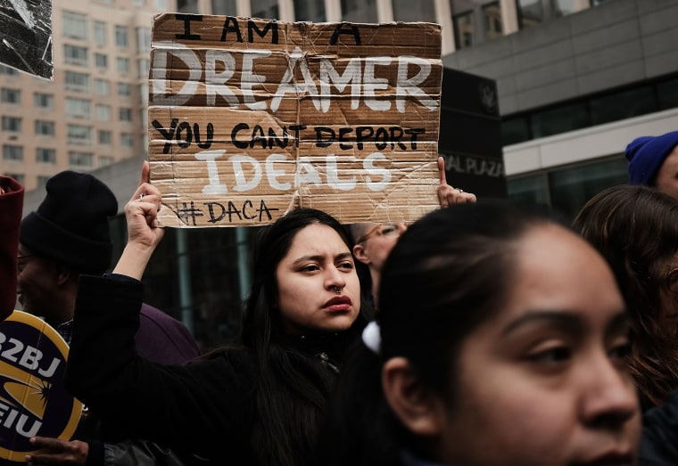 Image: Demonstrators protest the government shutdown and the lack of a deal on DACA