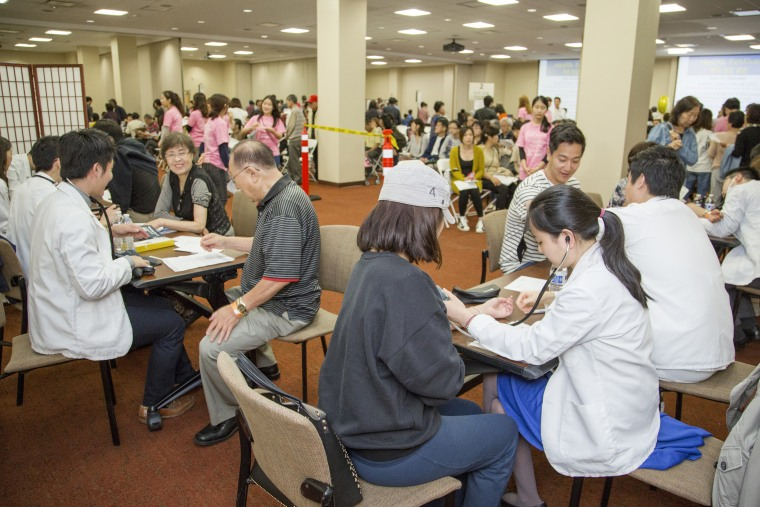 Patients meet with Asian Health Services staff at Holy Name Medical Center during Annual Health Festival on Sept. 26, 2015 at Holy Name Medical Center in Teaneck, New Jersey.
