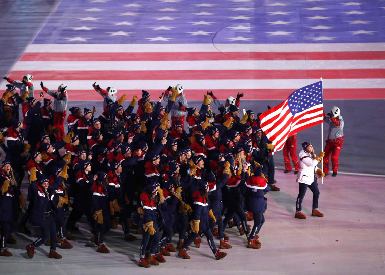 Image: Erin Hamlin of U.S. carries the national flag during the Olympics opening ceremony