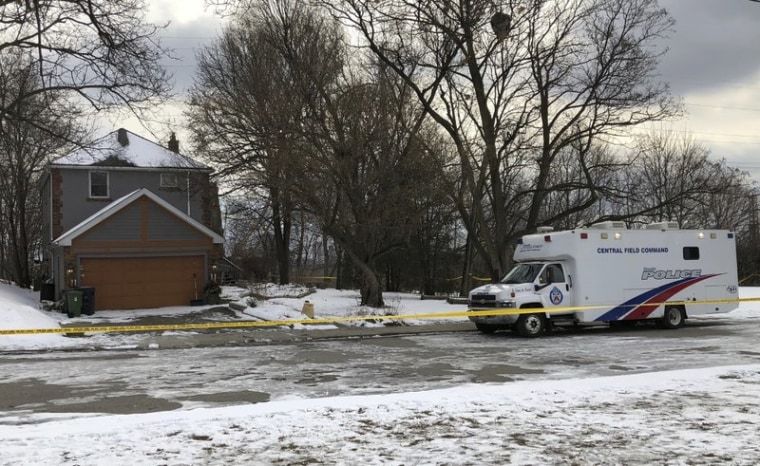 In this Feb. 3, 2018 file photo, crime scene tape surrounds a property where police say they recovered the remains of at least six people from planters on the property which is connected to alleged serial killer Bruce McArthur, in Toronto, Canada.
