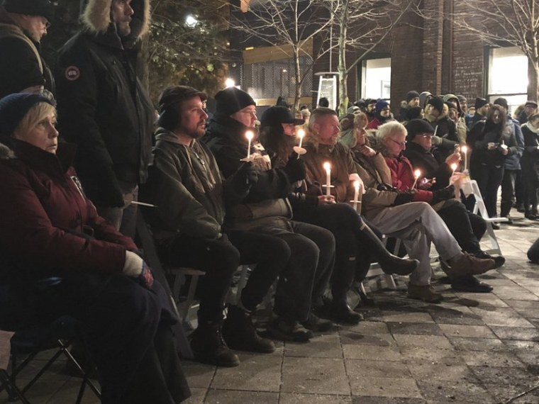 In this Feb. 13, 2018 photo, people hold a candlelight vigil to remember the victims of alleged serial killer Bruce McArthur in Toronto, Canada.