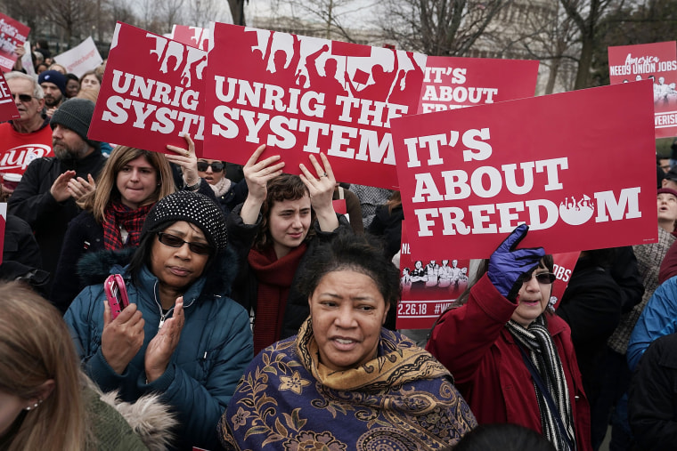Image: Activists rally in front of the U.S. Supreme Court