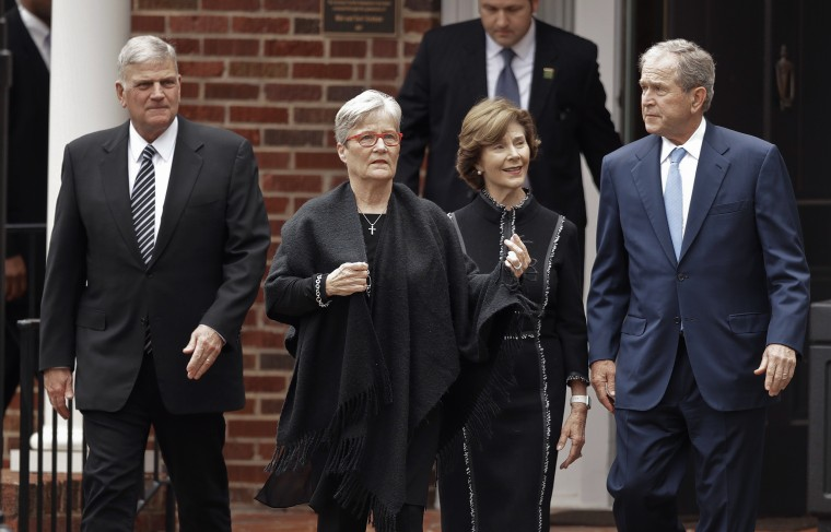 Image: George and Laura Bush after paying their respects to Billy Graham